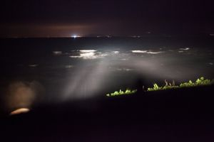 at night volunteers are spotting boats coming from the Turkish coast