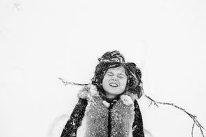 Bela makes snow angels