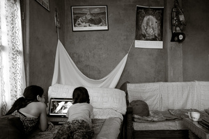 Ratna wood neices watching youtube.