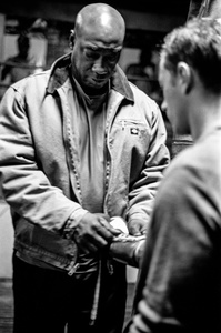 Actor Michael Clark Duncan, laces up boxing gloves.