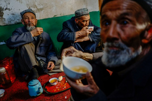 Uighur elders drinks tea at a secret tea house in old Kashgar, Xinjiang Uighur Autonomous Region, China.