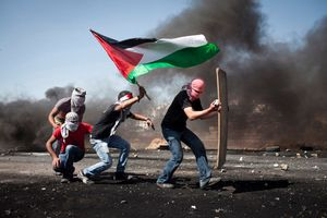 Palestinian youth advance towards Israeli soldiers during clashes outside Ofer Military Prison, West Bank, 2012.