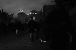 Evening shot of young man in Kiev with a cross to bear, February 2014.