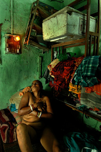 Prostitute in the red light district. Kolkata, India.