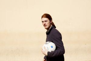 Alien with soccer ball.