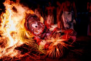 Theyyam performer casting himself into the fire in order to merge his body with celestial spirits.