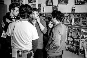 Crew discusses a scene.