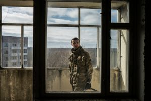 Vadim in a apartment in the ghost town of Pripyat.