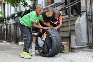 """""""We're going to get inside this tire and roll down the hill."""" """"No, you're not."""" """"Yes, we are!""""""""No, you're not."""" From """"Humans of New York: Stories."""" Published by St. Martin's Press."""