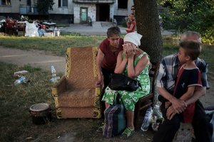 Local people in the courtyard of a multistory building destroyed after the battle for liberation from the pro-Russian militants. One of the entrances of the building was completely destroyed from the 9th to the 1st floor as a result of air strikes. July 28, 2014 Lisichansk, Lugansk region.