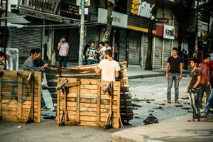 Far left-wing protesters building barricades during clashes with riot police at anti-government demonstration in Istanbul's Gazi neighborhood, Turkey.