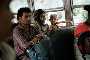 Amina and her parents have been travelling since dawn and are finally only one bus ride away from the hospital. Calcutta, West Bengal, India. May 31st 2019