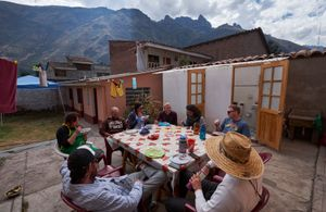 Andes Alliance for Sustainable Development staffers meet for lunch in the office's backyard