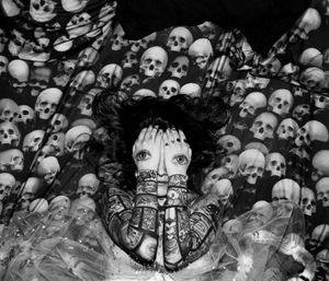 Lyubov Tulkina escapes the mortal coil sleeping on a bed covered in skulls. She is a graduate from Saint Petersburg Stieglitz State Academy of Art and Design and she dreams of reaching immortality by expressing herself in art, painting murals.