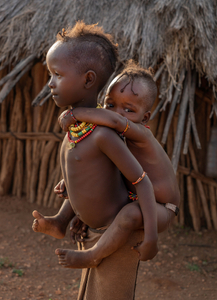 Child Caring for Toddler