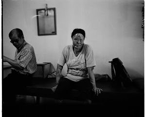 Ah Chin and her husband at home