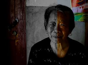 Village's old woman in her home.