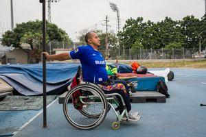 Joe Gonzalez Bettencourt, 38, warms up before the practice of weight throwing at Atanasio Girardot Stadium, Medellin, March 2016.