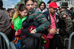 October 2015, Preshevo, Servië. On the Serbian side of the border with Macedonia thousands of refugees wait for whole days in the rain and cold to get registered by Serbian authorities. Often chaos erupts leading to tensions with police forces.