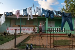 A woman standing in front of her house in Vinales town in Cuba