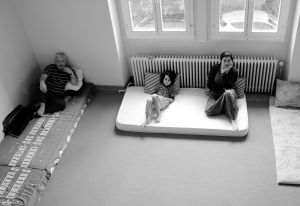 a newly arrived Syrian family in the room they share with 9 members of their extended family  © Alison McCauley