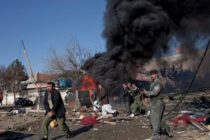 Afghan Security Forces secure the scene of a suicide car bomb in Kabul, Afghanistan on December 15, 2009. It was reported that eight people were killed and 40 were wounded. © Adam Ferguson