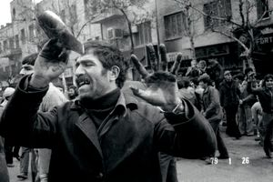 A rioter holds up his bloody hands during a violent protest against the imperial regime of the Shah in Tehran, IRAN - January 26, 1979 © Copyright 1979-2009 Alfred Yaghobzadeh. All rights reserved.