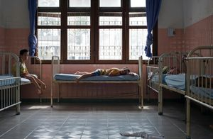 Children with deformed limbs get ready for a daily nap.