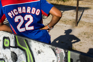 A player takes a break during weekly training. He wear the shirt of one of his favorite Dominican players.