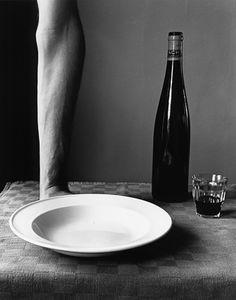 Arm and wine bottle