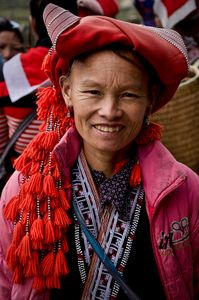 The full beauty and detail of the Red Dao minority head piece can be seen in this portrait.