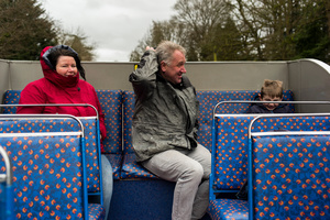 A bit nippy, hoods UP, aboard a cabriolet bus in the park.