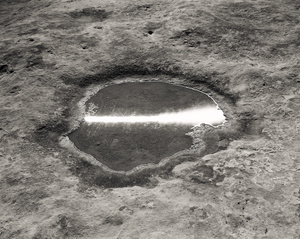 Reflection of the Transit of the Sun in a Puddle, Canyonlands, Utah