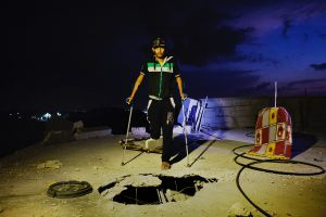 20 years old amputee Ameer Abu Jama'a hit by Israeli artillery during the summer's 50 day war between Israel and Hamas poses at the rooftop of his destroyed home, due to Israel shelling.Al-Zana'a in Khan Yunis.