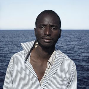 Mediterranean Sea, 1 August 2016. Musa (18), from Gambia, poses for a portrait minutes after being rescued on the Mediterranean Sea, 20 nautical miles off the Libyan coast by a rescue vessel provided by the NGO Jugend Rettet. The rubber boat in which he travelled carried 118 people on board, who were transferred by the Italian Coast Guard to Lampedusa (Italy).