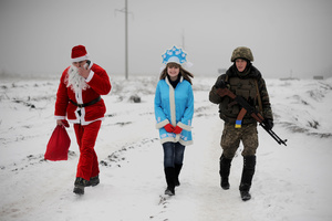 THE THIRD IS NOT SUPERFLUOUS. January 2, 2015 . Santa Claus and a snow princess greet soldiers at the checkpoints during New Year's. Local residents donned the costumes to create a holiday atmosphere and to thank the Ukrainian army for liberating their city.