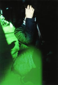Woman in the street with green memory