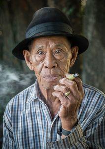 Elderly Man at Cattle Market, Northern Thailand