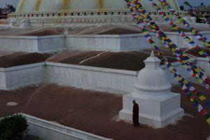 A monk circumambulates around Boudhanath Stupa