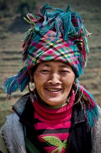 H'mong lady in the rice terraces at Ta'van. Like this lady many H'mong mix traditional and western clothes in their daily outfits.