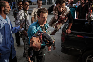 A young boy injured by a sniper is rushed into hospital. Unfortunately, the doctors were only able to certify death.