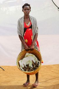 A. Barbara: Sells dry fish for 4 pieces for 3,000 shillings. Earns about 10,000 to 12,000 shillings per day.