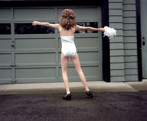 Katie dancing in driveway, 1997. © Blake Fitch