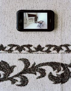 """Former Detainees iPhone at his Home with Image of his Solitary Cofinement Cell from """"If The Light Goes Out: Home from Guantanamo"""" © Edmund Clark"""