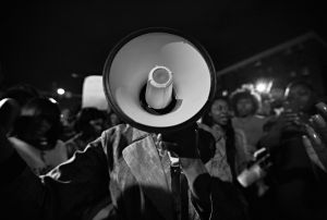 Baltimore, MD- State Senator Majority Leader Catherine Pugh (D) using the bullhorn to ask protesters to comply with the 10:00 PM curfew and go home to avoid conflict with the police.