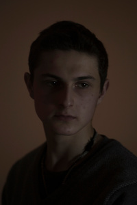 Roman, 18, student of marketing, picture was taken after he spent 6 months in the war zone, January 2015, Ukraine.