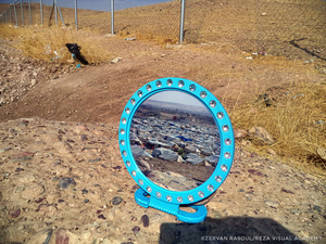 The camp reflected in a mirror. Zeraf Rasoul, a young refugee who fled Damascus on August 17, 2013 brought out his mirror as part of an exercise set by Reza: to picture your life in a reflection.