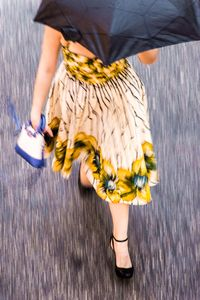 Woman with Umbrella, 42nd Street, NYC, 2016