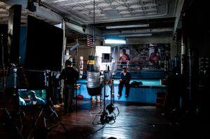Cast & crew prepare for a scene.
