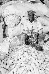 Women Workers. Manioc flour seller